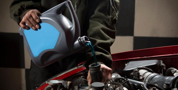 Have Car Antifreeze Flushed - Cottman Man - Cottman Transmission and Total Auto Care