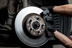 Car Brake Light Service - Cottman Man - Cottman Transmission and Total Auto Care